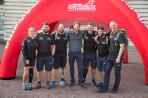 (left to right) Kirsty Ennis, Andrew Bement, Matt Fisher, Prince Harry, Alec Robotham, Scott Ransley and Stewart Hill, as he welcomes the ex-service personnel who have travelled the length and breadth of Britain over 72 days since starting in Moray, Scotland, in August, as part of Walking With The Wounded (WWTW) Walk of Britain, as they reach the finishing line at Buckingham Palace in central London.